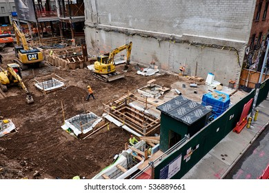 NEW YORK CITY - SEPTEMBER 28, 2016: Building site in the Chelsea area where excavators are working on soil above a new basement