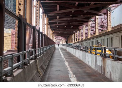 NEW YORK CITY - SEPTEMBER 29, 2016: Man biking and cars driving on the ramps from Ed Koch Queensboro Bridge