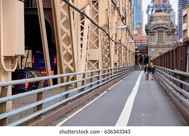 NEW YORK CITY - SEPTEMBER 29, 2016: Mother and daughter walking in the pedestrian lane on Ed Koch Queensboro Bridge