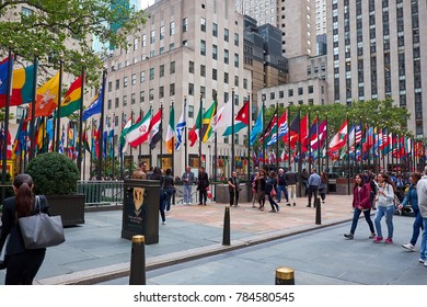 NEW YORK CITY - SEPTEMBER 29, 2016: Many people walking on the pedestrian are around Rockefeller Plaza with all the flags