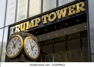 NEW YORK CITY - SEPTEMBER 3, 2016: Polished brass sign for Trump Tower shines above branded clocks on Fifth Avenue.