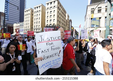 NEW YORK CITY - SEPTEMBER 4 2014: fast food workers and their supporters marched along 8th Ave calling for an increase in the minimum wage.Some attempted to block the street leading to several arrests