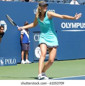 NEW YORK CITY - SEPTEMBER 4:- Maria Sharapova gets ready to return the ball at Arthur Ashe stadium during the US Open on September 4, 2010 in New York City.