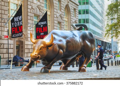 """NEW YORK CITY - September 5: Charging Bull sculpture on September 5, 2015 in New York City. The sculpture is both a popular tourist destination, as well as """"one of the most iconic images of New York""""."""