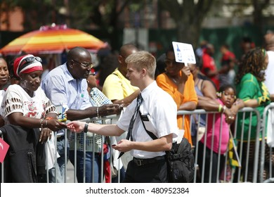 NEW YORK CITY - SEPTEMBER 5 2016: the annual East Indian Day Parade along Eastern Parkway is one of the largest public events in North America. Mormon missionaries.