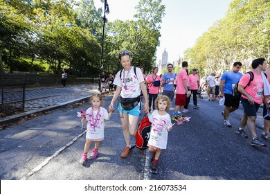 NEW YORK CITY - SEPTEMBER 7 2014: the annual Susan G Komen Foundation Race for the Cure filled Central Park West with thousands dedicated to raising funds & awareness for breast cancer research