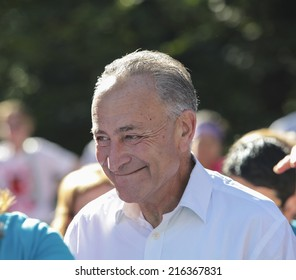 NEW YORK CITY - SEPTEMBER 7 2014: the Susan G Komen Race for the Cure took place along Central Park West with participants raising funds & awareness for breast cancer. US Senator Charles Schumer,