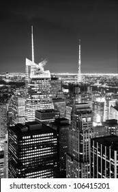 New York City skyline aerial view at dusk with skyscrapers of midtown Manhattan in black and white.