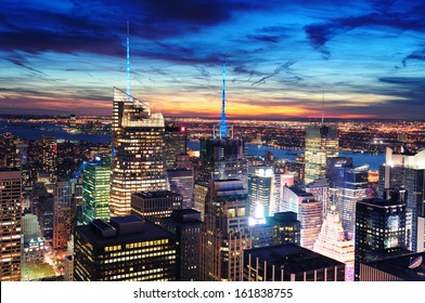 New York City skyline aerial view at dusk with skyscrapers of midtown Manhattan.