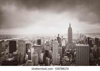 New York City skyline. Aerial view over Manhattan on a cloudy day. Sepia toned image. Old photo stylization.