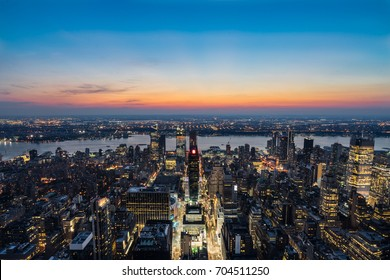 New York City skyline aerial view with urban skyscrapers and Hudson river at sunset during summer. Viewing from the Empire State Building.