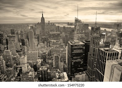 New York City skyline black and white with urban skyscrapers at sunset.