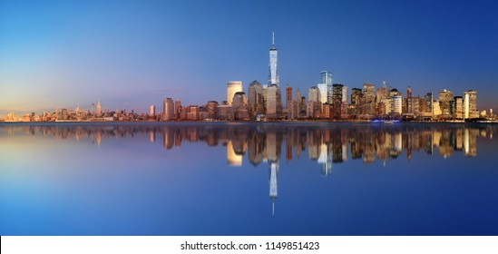 New York City skyline blend with day and night panorama with reflection