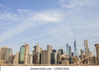 New york city skyline from Brooklyn Bridge during sunrise.