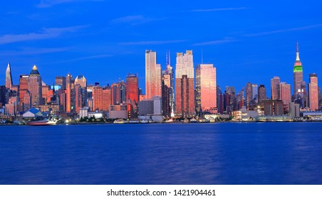 New York City skyline at dusk reflected in Hudson River, USA