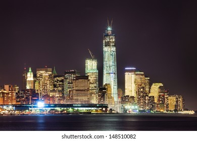 New York City skyline at night w the Freedom tower under construction