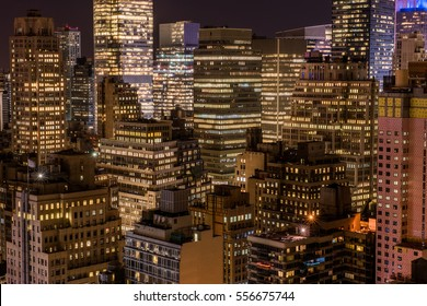 New York City skyline at nighttime with bright lights from the buildings