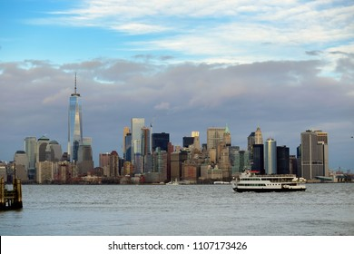 New York City skyline over the Hudson River in a cloudy weather.