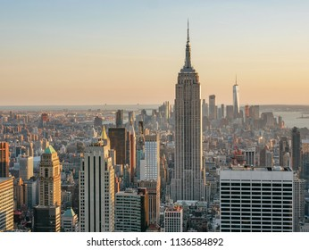 New York City Skyline with urban skyscraper at sunset