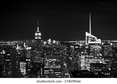 New York City skyline with urban skyscrapers at night, in black and white.