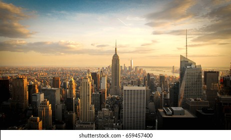 New York City skyline with urban skyscrapers on the top of the world at sunset