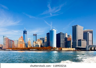 New York City skyline and waterfront viewed from the water facing lower Manhattan. Wide angle view includes the new World Trade Center under construction.