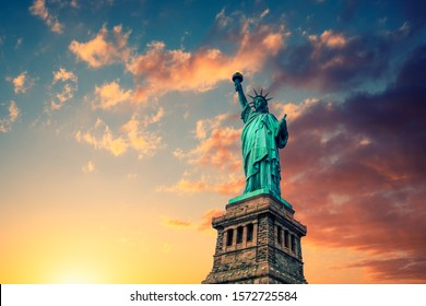 New York City, The Statue of Liberty at sunset with a beautiful vanilla sky.