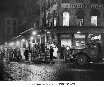 New York City street at night, circa late 1930s.