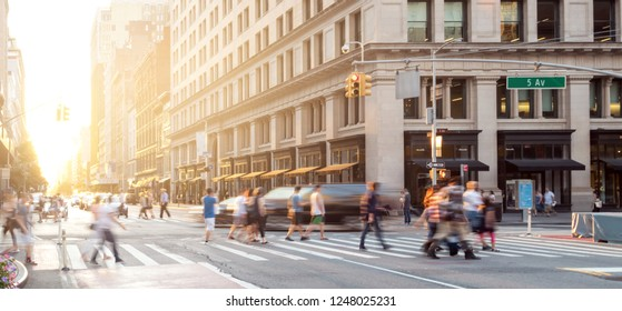 New York City street scene with crowds of people walking in Midtown Manhattan and sunlight background