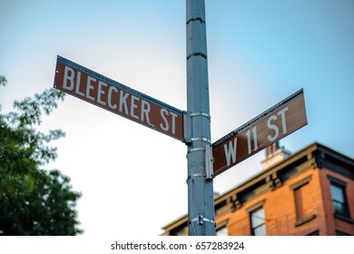 New York City street signs at the junction of Bleecker and 11th Streets in Greenwich Village, downtown Manhattan