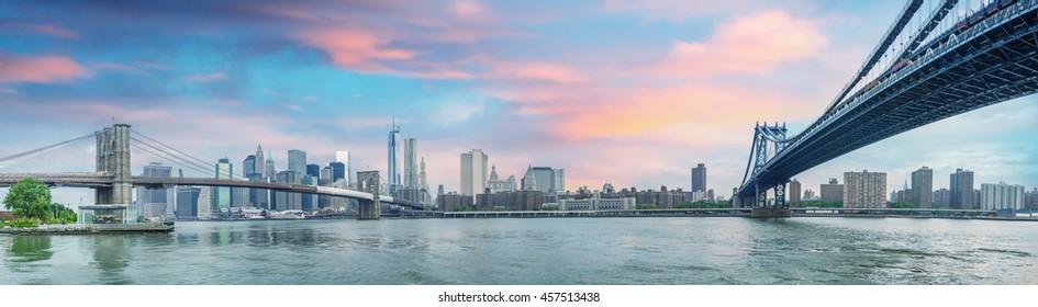 New York City - Stunning panoramic view of Brooklyn and Manhattan Bridge with skyline.