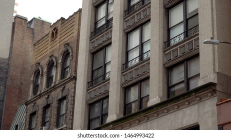 New York City style luxury apartment building day time exterior establishing shot of generic typical structure
