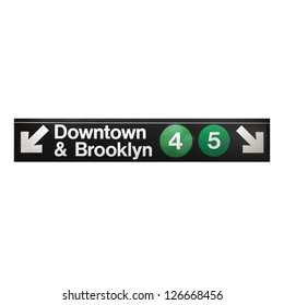 New York city subway sign in midtown Manhattan indicating Downtown and Brooklyn.