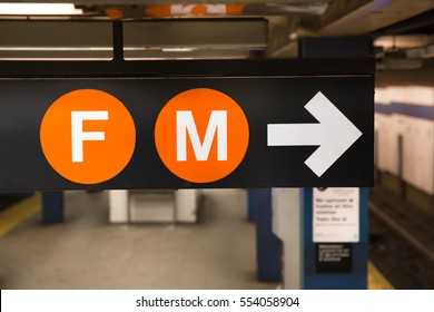 New York City subway sign for the F and M trains