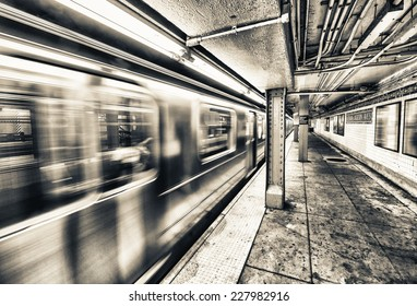 New York City subway train speeding up.