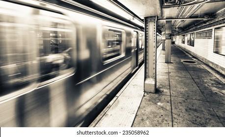 New York City subway train speeding up.