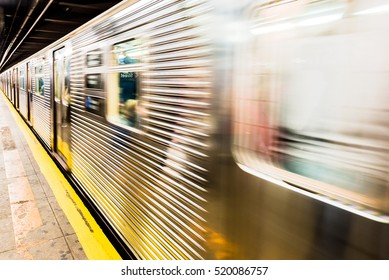 New York City subway train leaving its station - motion blur as