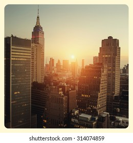 New York city with sunset across horizon with Instagram style filter
