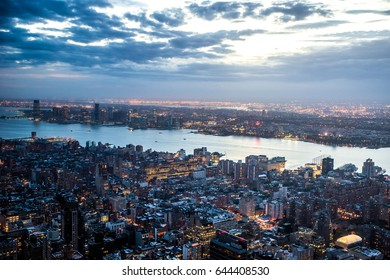 New York City sunset skyline aerial view with office buildings,skyscrapers and Hudson River.