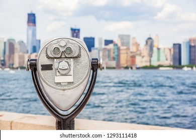 New York City tourism travel background tourist icon - coin operated binocular tower viewer with skyline view in summer. USA destination.