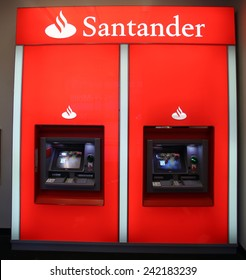 NEW YORK CITY - TUESDAY, DEC. 30, 2014: A pair of Santander Bank ATM. Santander Consumer USA Inc is wholly owned by the Spanish Santander Group.