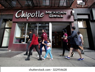 NEW YORK CITY - TUESDAY, SEPTEMBER 22, 2015: Pedestrians walk past a Chipotle Mexican fast food restaurant.  Chipotle Mexican Grill, Inc. is a chain of restaurants.