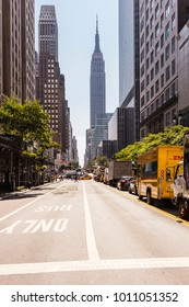 New York City, United States - August 24, 2017: West 34th Street with cars and the Empire State Building in the background.