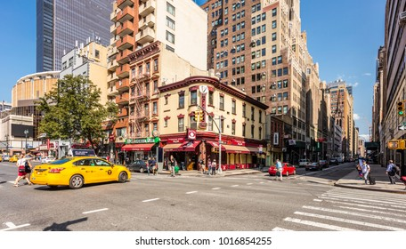 New York City, United States - August 26, 2017: On the corner of Eighth Avenue and West 32th Street.