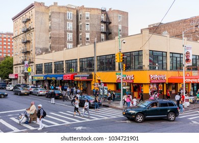 New York City, United States - August 25, 2017: Harlem neighborhood, Manhattan. At the corner of St. Nicholas Avenue and W 125th Street (Martin Luther King Boulevard).