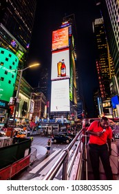 New York City, United States - August 25, 2017: Tourist guide on a sightseeing bus going through Times Square, at night.