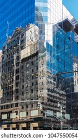 New York City, United States - August 25, 2008: The glass windows of the Safra National Bank building reflect the facades of other buildings (Fifth Avenue, Midtown Manhattan).