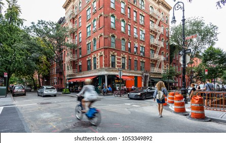 New York City, United States - August 25, 2017: Corner of West 4th Street and Perry Street, with customers sitting at the tables of an Italian restaurant (West Village, Greenwich Village, Manhattan).