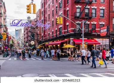 New York City, United States - August 26, 2017: Corner of Mulberry Street and Broome Street, Manhattan, with Little Italy Sign.