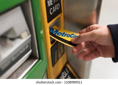 New York City, New York, United States - February 18, 2018: Purchasing more travel credits with the Metro Card to ride N.Y. subway. Inserting card into machine.